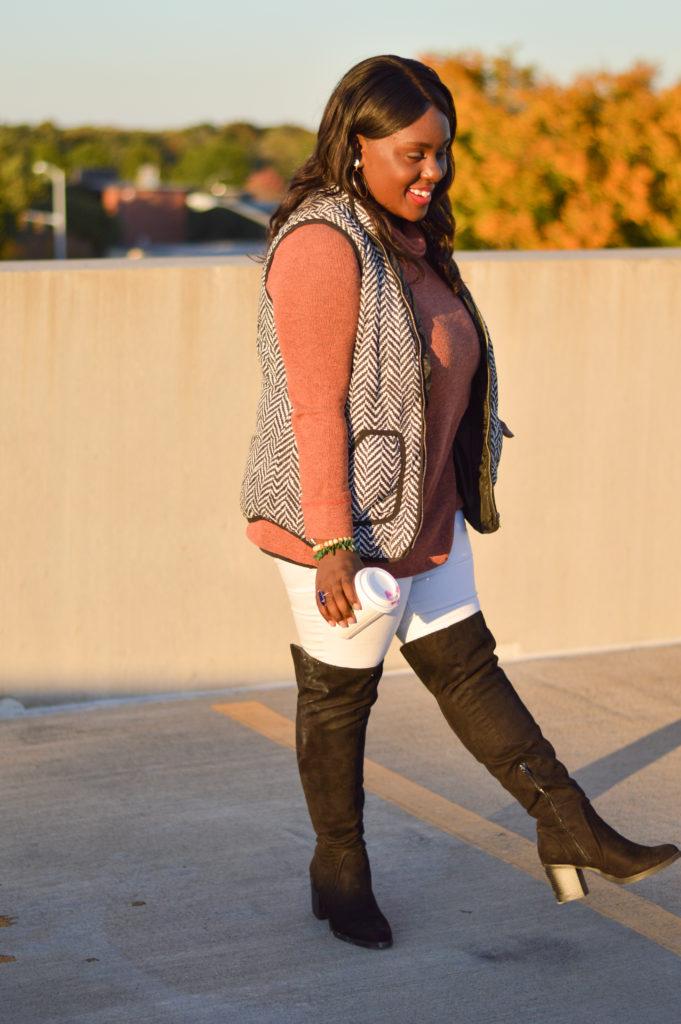 Herringbone Vest Rust Cowl Neck Sweater White Jeans Over The Knee Boots Gold Hoop Earrings