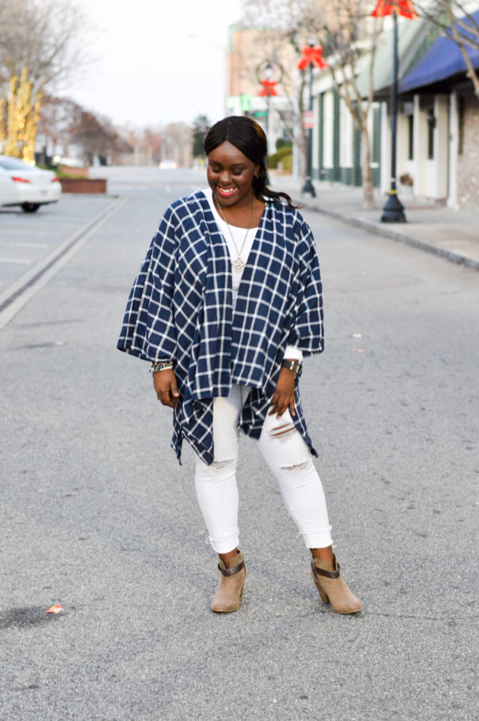 Styling white jeans and blue poncho for a casual look during winter